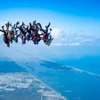 Skydivers flying head down photo edited by Elliot Byrd on Sharing Perspectives Icarus Canopies blog