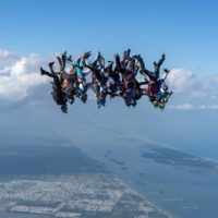 Skydivers flying head down photo edited by Sam Millington on Sharing Perspectives Icarus Canopies blog