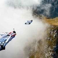 Wingsuit BASE in mountains through cloud photo by Scott Patterson edited on Icarus skydiving photography blog