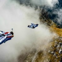 Wingsuit BASE in mountains through cloud photo by Scott Patterson edited by Chris Stewart on Icarus skydiving photography blog