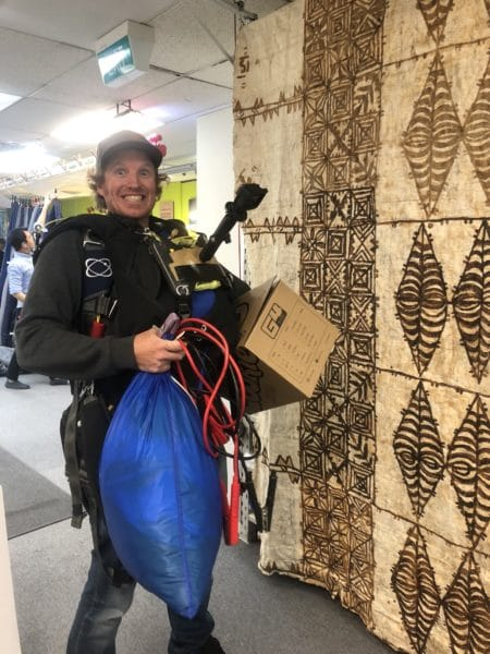 test jumper chris snell carrying skydive gear at NZA factory