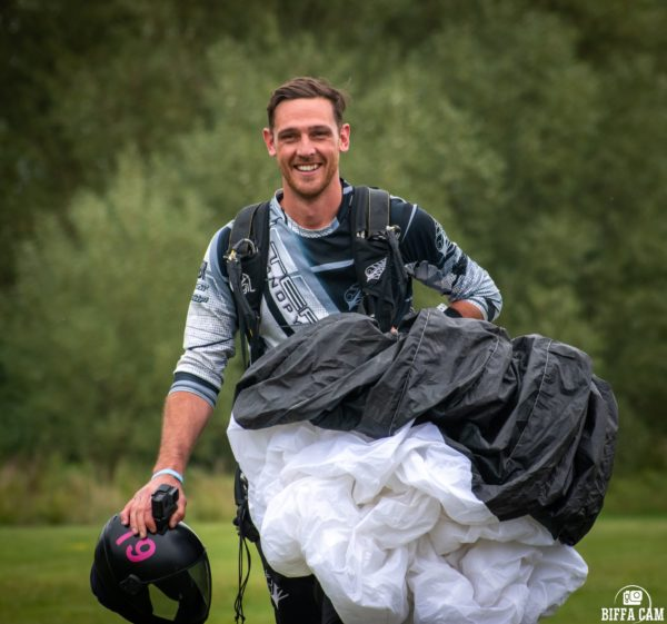chris stewart walking with Petra in hand after landing